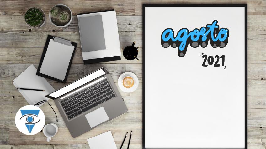 Escritorio con una computadora, un café y plantas